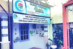 papan nama Klinik Raisha